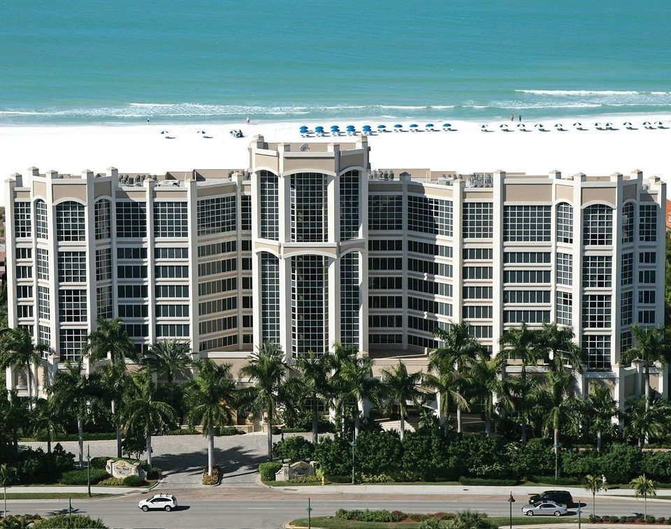 Beachfront Exterior Waterfront building sky condominium property tower block residential area City neighbourhood Downtown plaza headquarters Resort