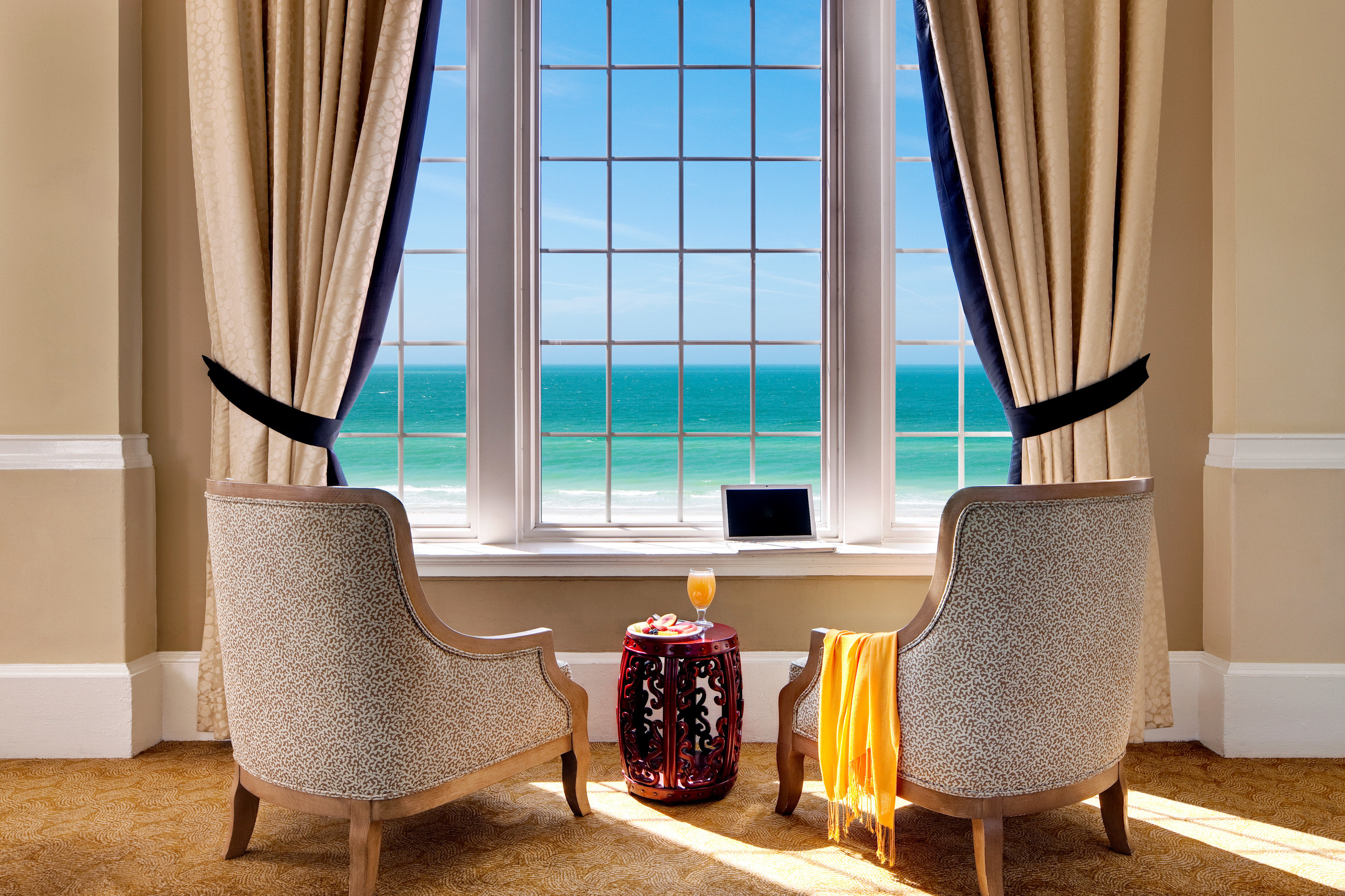 Beachfront Classic Drink Family Resort curtain chair property Suite living room home window treatment textile