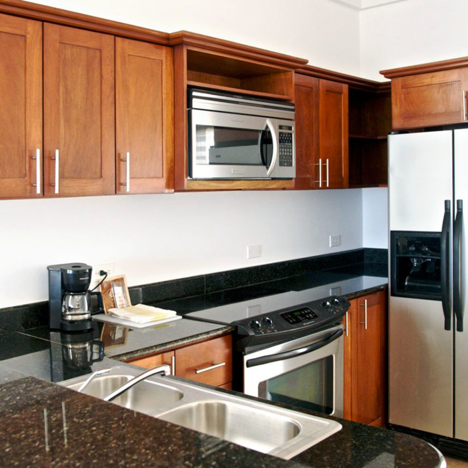 Beachfront Classic Kitchen Resort cabinet stainless steel appliance counter property stove microwave cabinetry oven countertop kitchen appliance wooden home cuisine classique black cottage cuisine silver