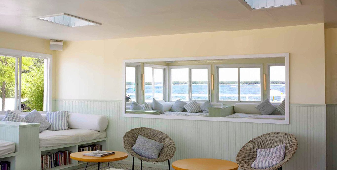 Beachfront Classic New York Romance Scenic views Trip Ideas Weekend Getaways property condominium yellow living room home Villa daylighting cottage