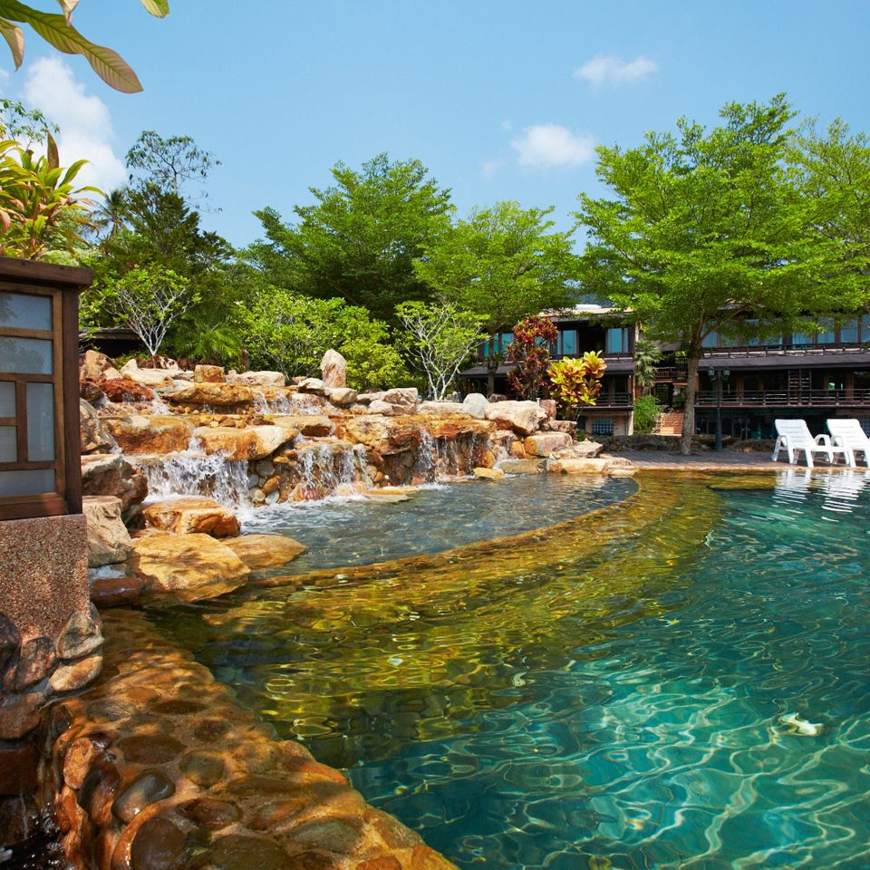 Beachfront Classic Pool tree swimming pool property rock Resort backyard pond Village stone