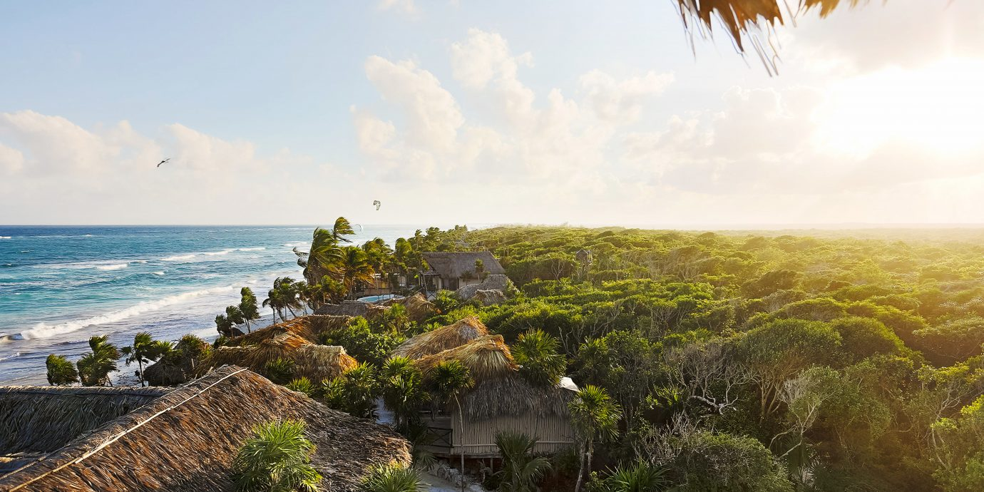 Beachfront Eco Grounds Hotels Island sky Nature Coast Sea tree ecosystem horizon Ocean shore morning rock sunlight landscape cliff terrain arecales tropics