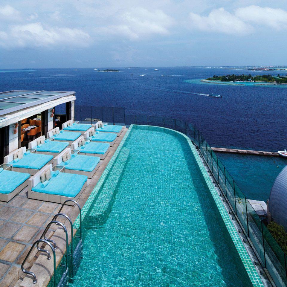 Beachfront Elegant Lounge Luxury Ocean Pool sky water swimming pool Sea vehicle marina caribbean Coast dock passenger ship Resort blue overlooking shore