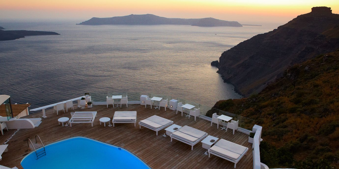 Beachfront Luxury Ocean Pool Sunset sky water mountain chair Nature overlooking Sea Coast atmosphere of earth cape vehicle promontory