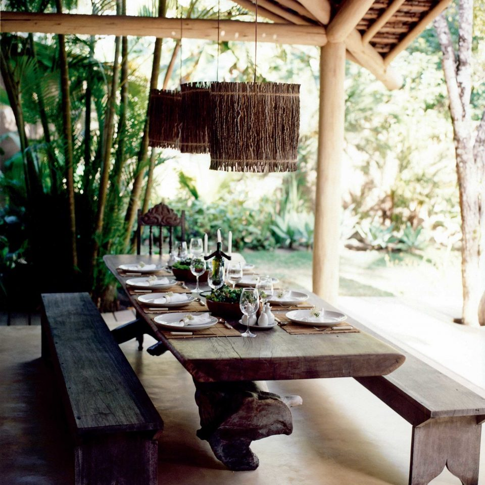 Beachfront Cultural Dining Drink Eat Outdoors Rustic Tropical Waterfront building house home Resort backyard outdoor structure cottage living room farmhouse Courtyard porch Villa stone