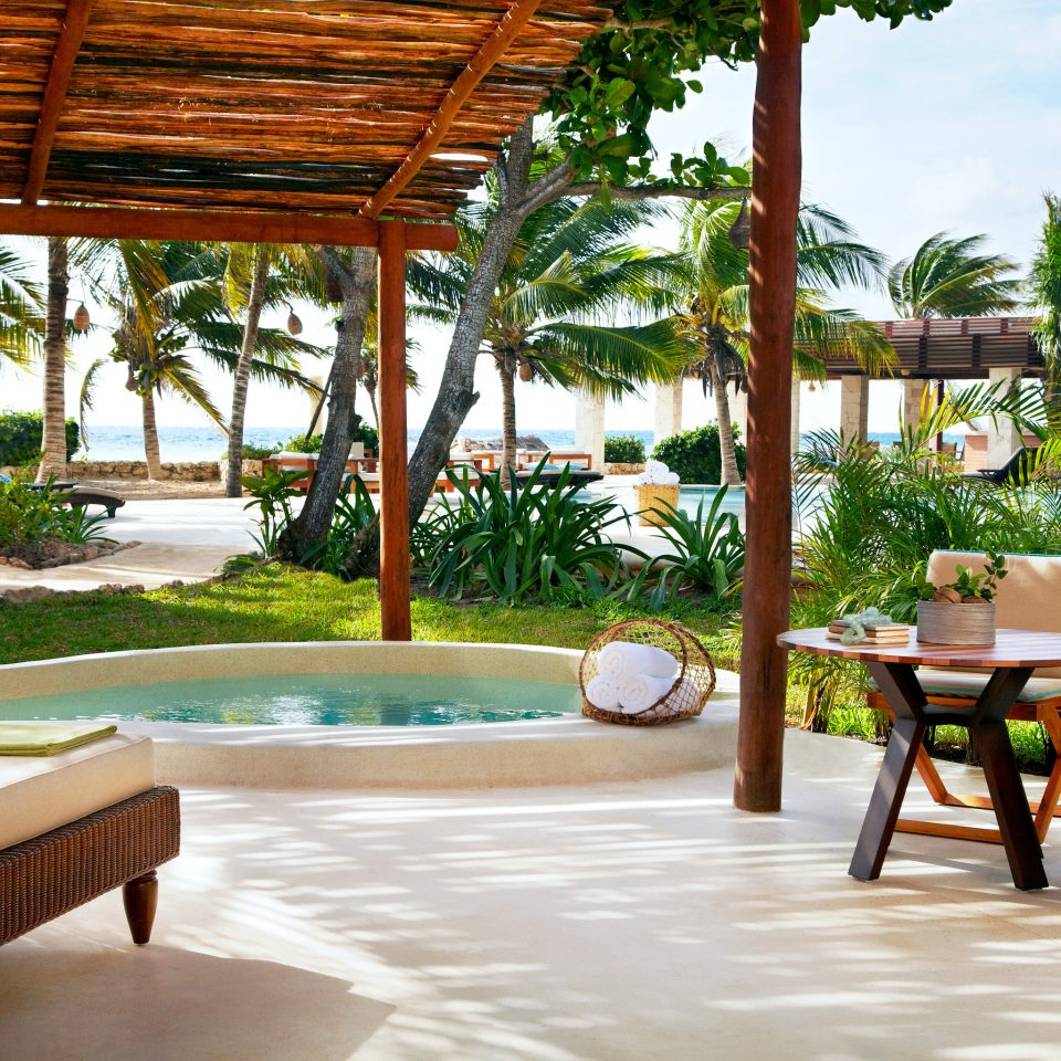 Beachfront Eco Patio Pool Romantic Terrace Tropical tree chair property Resort wooden building Villa home hacienda backyard swimming pool restaurant eco hotel condominium Courtyard Dining porch Deck