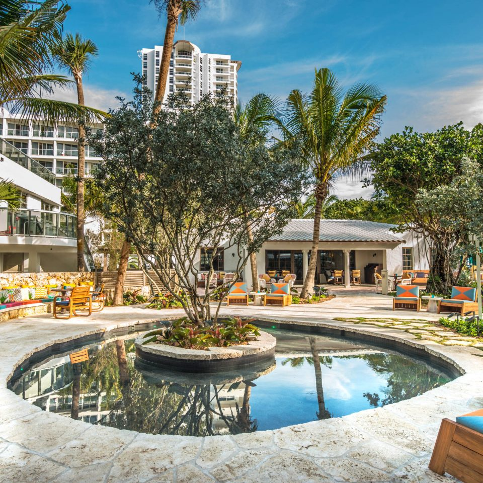Beachfront Grounds Lounge Resort tree leisure chair plaza swimming pool condominium home palace Courtyard lined