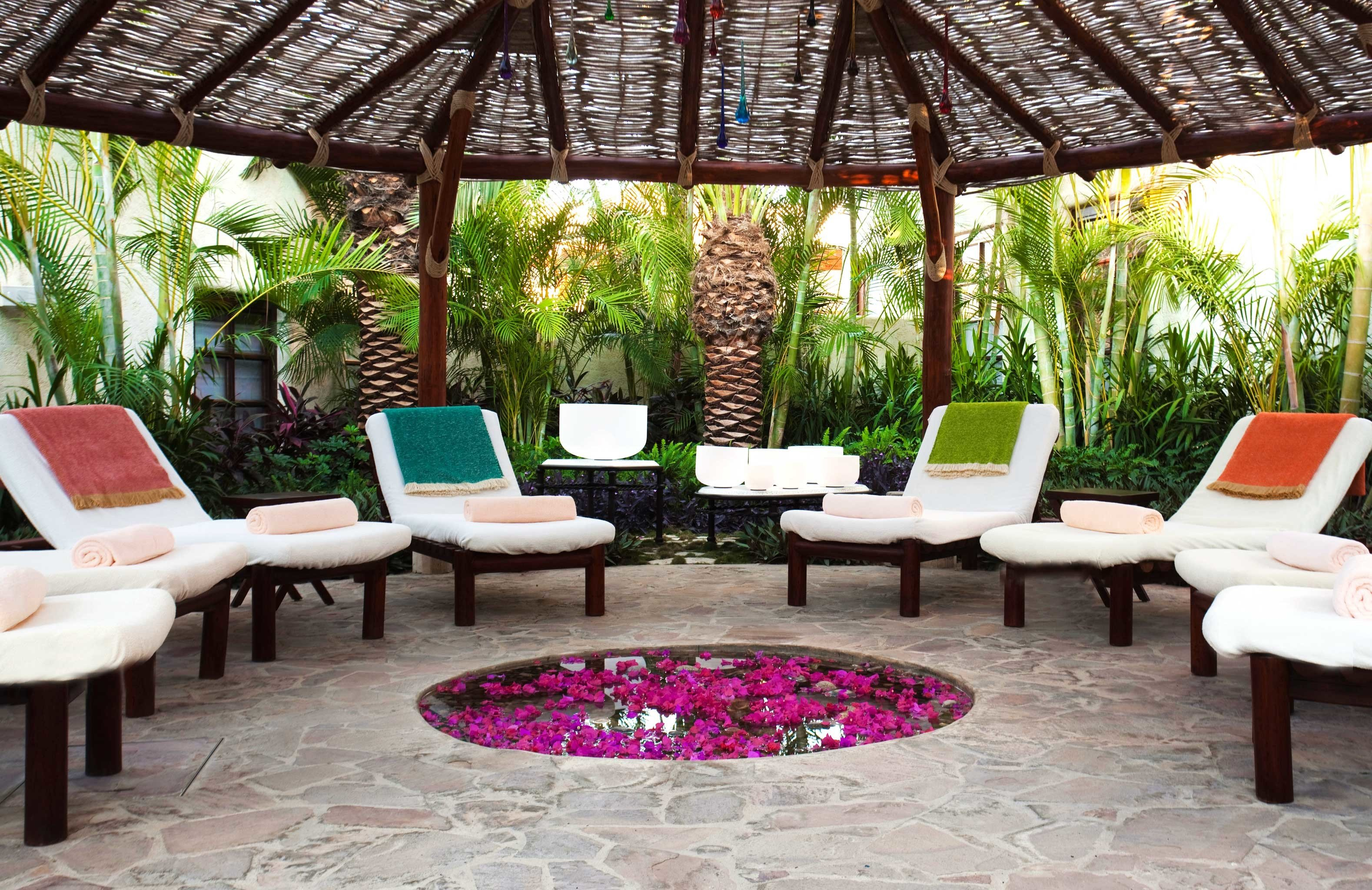 Beachfront Lounge Scenic views Tropical tree property chair Resort backyard outdoor structure Courtyard restaurant Villa Patio hacienda cottage