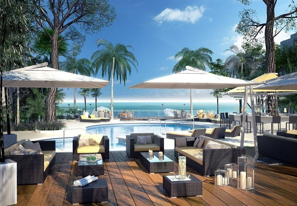 Beachfront Dining Drink Eat Hip tree chair property Resort restaurant Villa condominium eco hotel Deck set
