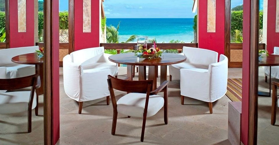 Beachfront Deck Dining Drink Eat Elegant Romantic Scenic views chair property restaurant Suite Resort nice hacienda Villa cottage overlooking dining table