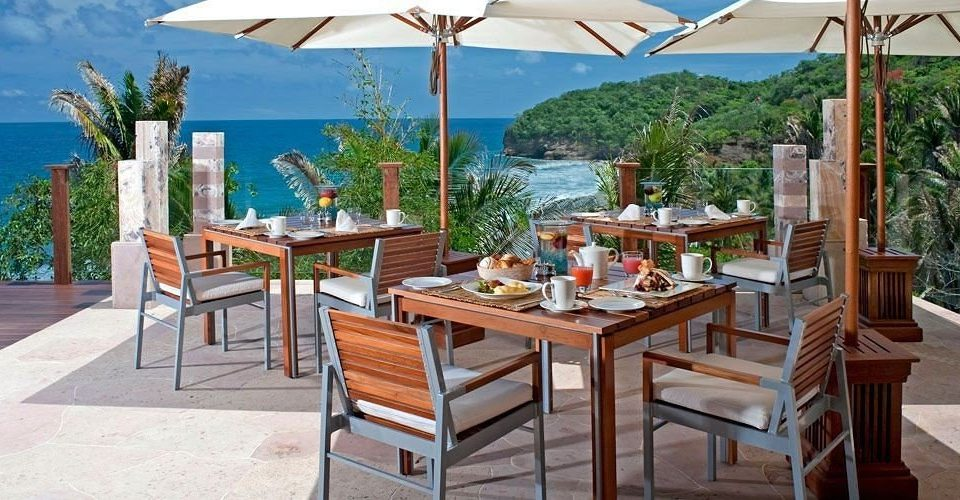 Beachfront Deck Dining Drink Eat Elegant Romantic Scenic views tree chair umbrella property Resort Villa cottage outdoor structure hacienda restaurant backyard set