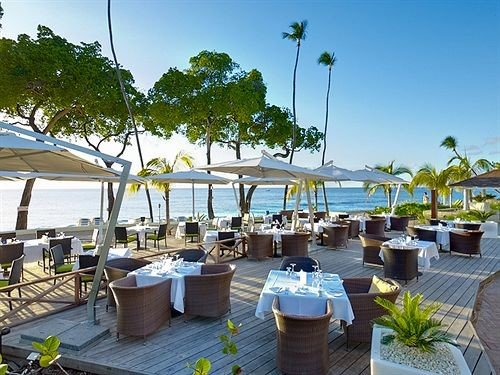 Beachfront Dining Drink Eat sky tree leisure property Resort marina caribbean dock Villa restaurant Deck