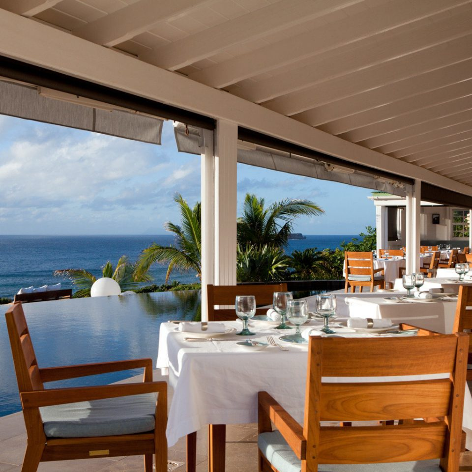 Beachfront Dining Drink Eat Resort Scenic views chair property restaurant Deck Villa overlooking porch Island