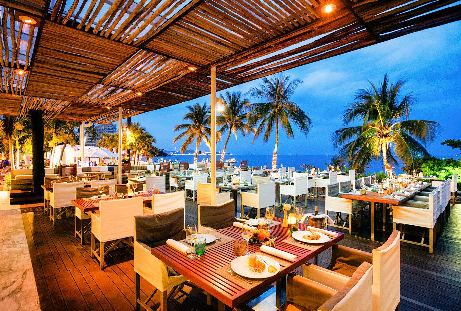Beachfront Deck Dining Drink Eat Family Honeymoon Island Outdoors Resort Romance Sunset restaurant