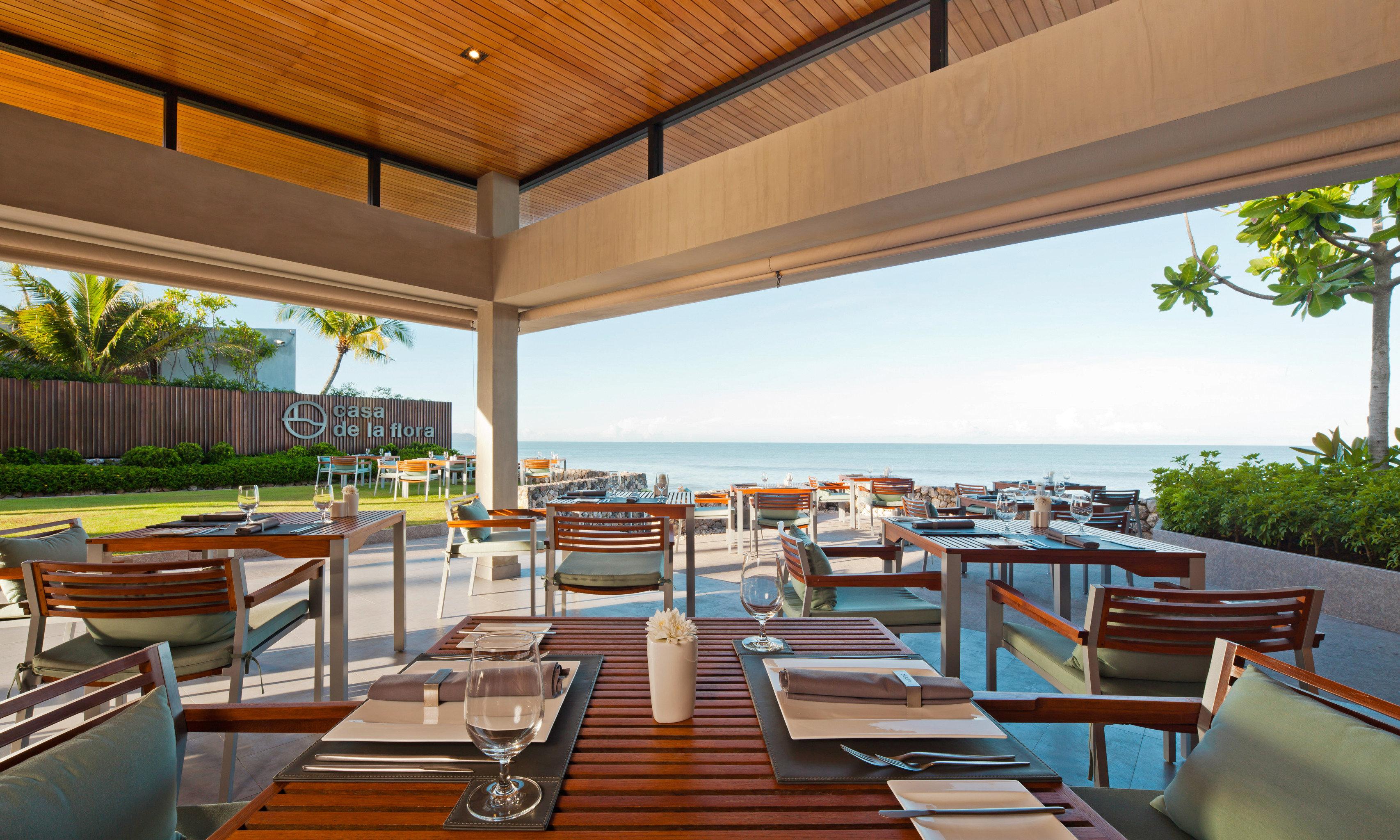 Beachfront Deck Dining Drink Eat Modern Romantic chair Resort property leisure wooden Villa condominium swimming pool home restaurant overlooking