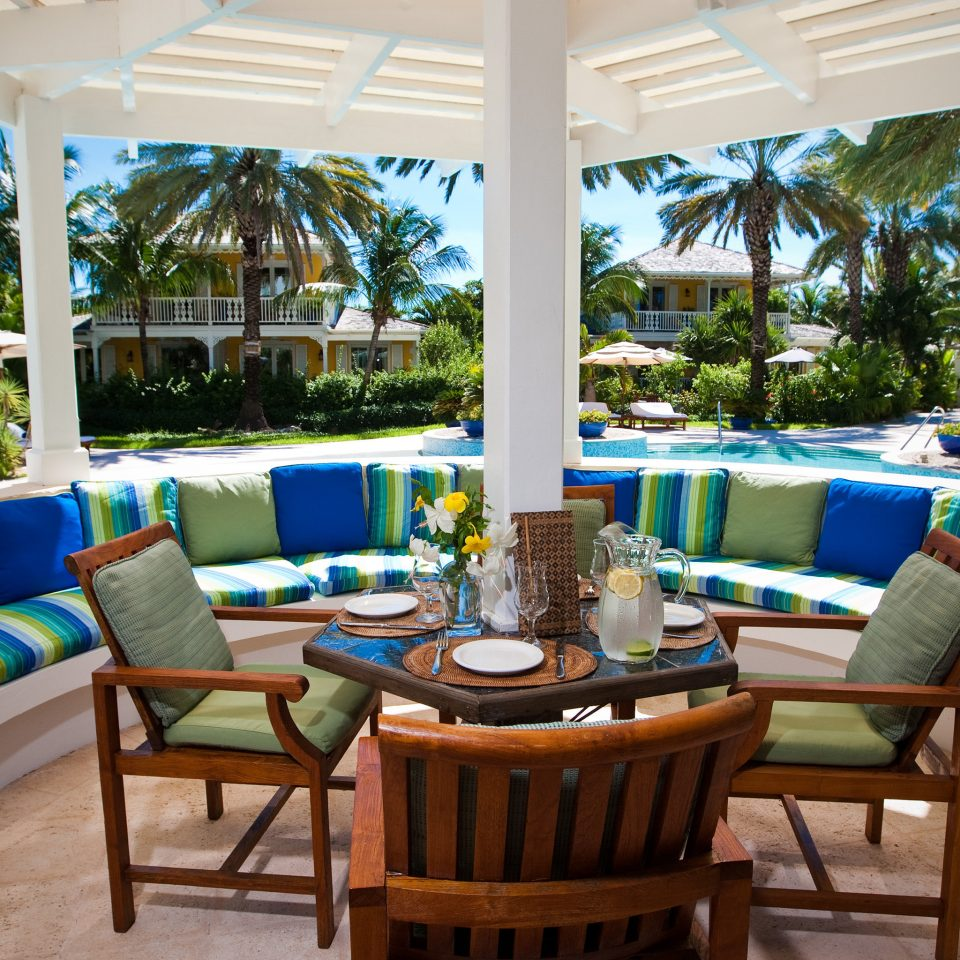 Beachfront Deck Family Hotels Luxury Resort Scenic views Trip Ideas property chair Villa home backyard Dining cottage porch restaurant living room mansion