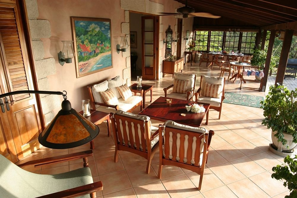 Beachfront Deck Grounds Historic Lobby chair property building home Resort house Villa cottage living room restaurant mansion Dining dining table