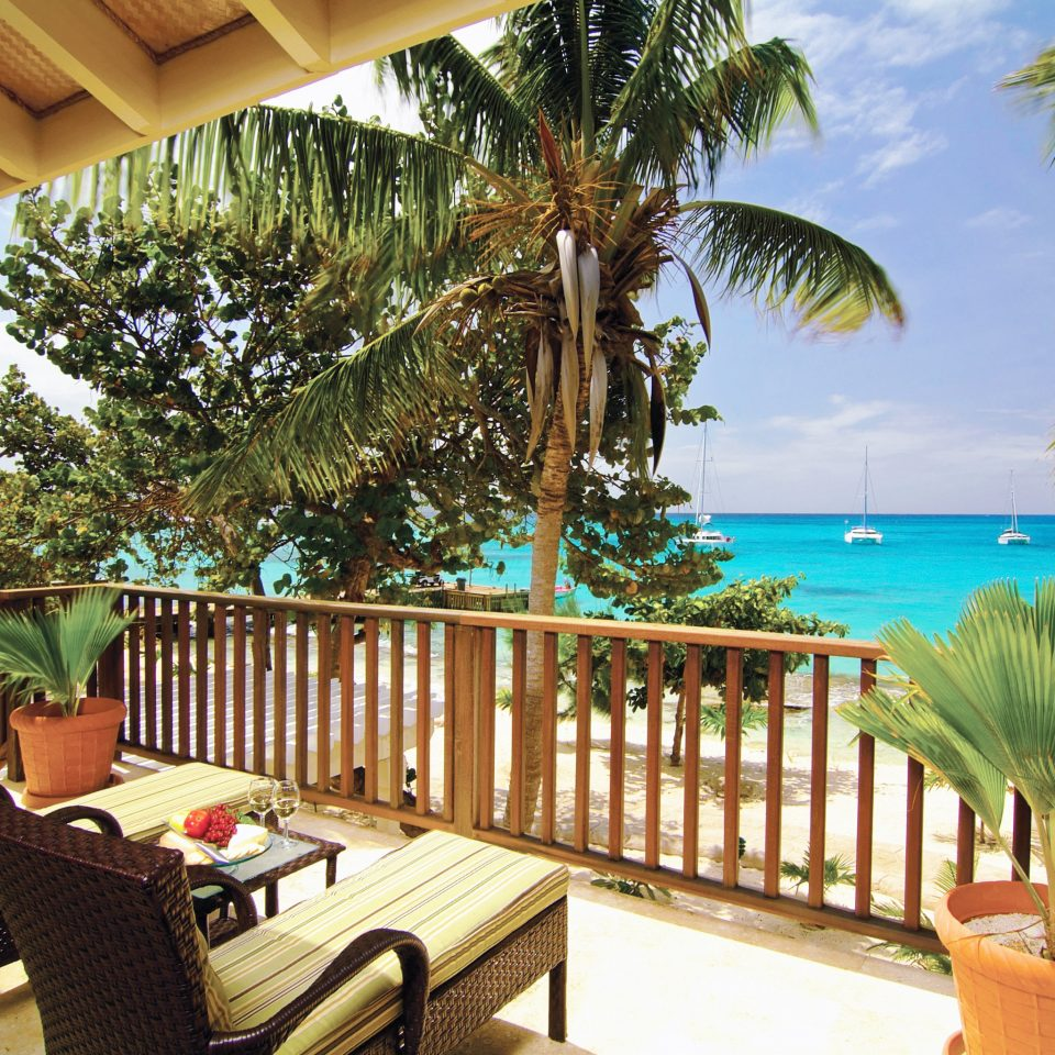 Beachfront Deck Hotels Play Resort tree chair property leisure caribbean Villa swimming pool Dining eco hotel plant palm