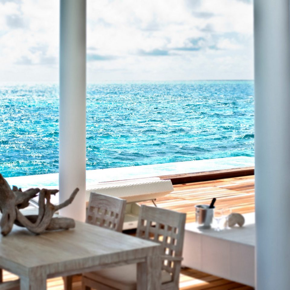 Beachfront Deck Dining Resort water sky chair overlooking leisure Ocean swimming pool caribbean yacht Sea Villa Island shore
