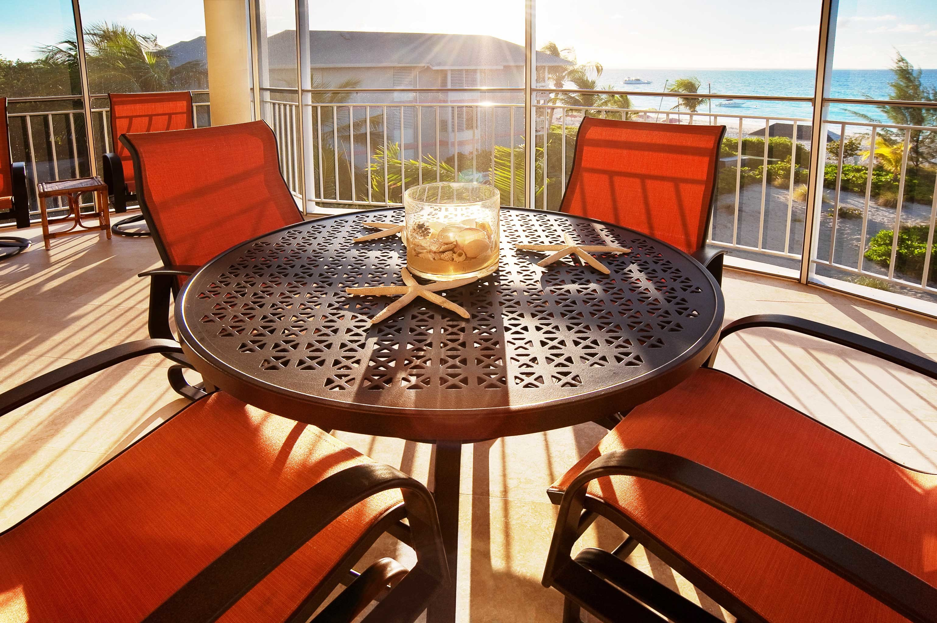 Beachfront Deck Dining Resort Scenic views chair wooden vehicle restaurant yacht dining table