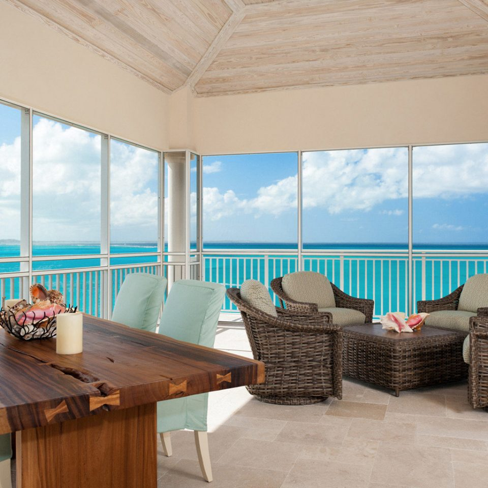 Beachfront Deck Eat Scenic views chair property building swimming pool Villa condominium Suite home cottage living room Resort