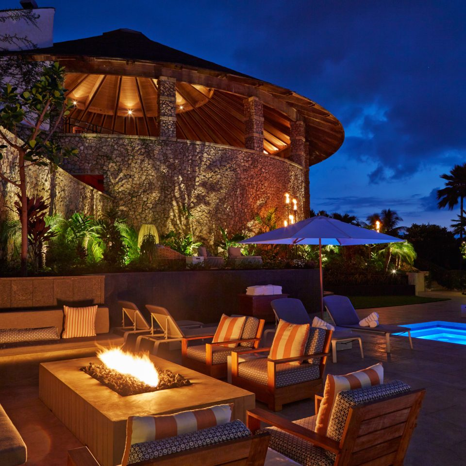 Beachfront Deck Eco Fireplace Hotels Island Lounge Patio Pool Romance Romantic Scenic views Sunset Waterfront Resort Villa landscape lighting swimming pool