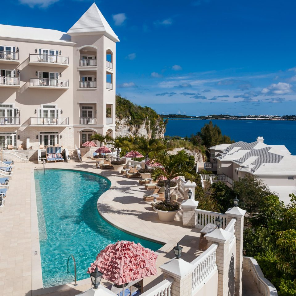 Beachfront Deck Exterior Island Pool Tropical Waterfront sky leisure property Resort Town resort town marina swimming pool caribbean palace Sea condominium Villa mansion Village