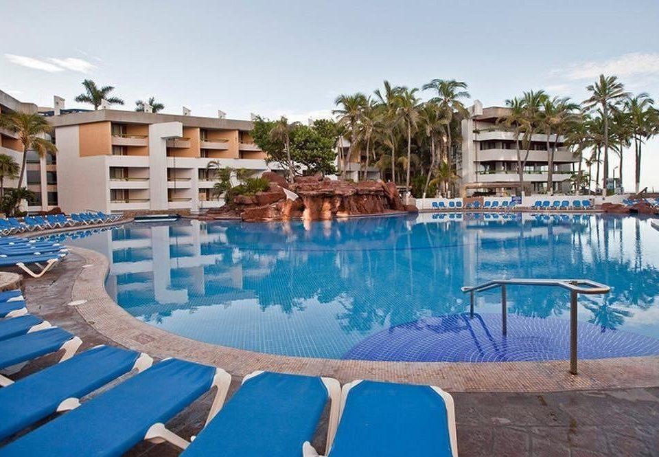 Beachfront Exterior Pool Resort sky chair swimming pool property leisure condominium resort town blue Villa backyard lawn Deck swimming