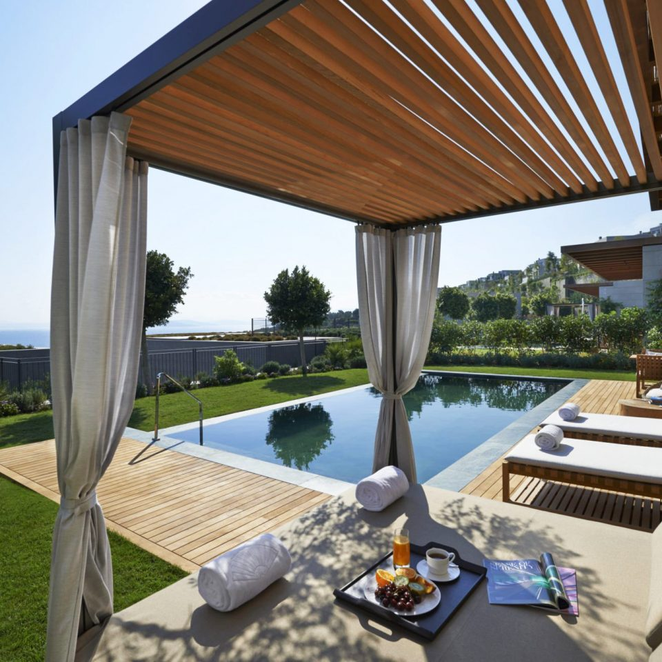 Beachfront Deck Lounge Luxury Modern Pool sky property Villa home Resort cottage outdoor structure backyard
