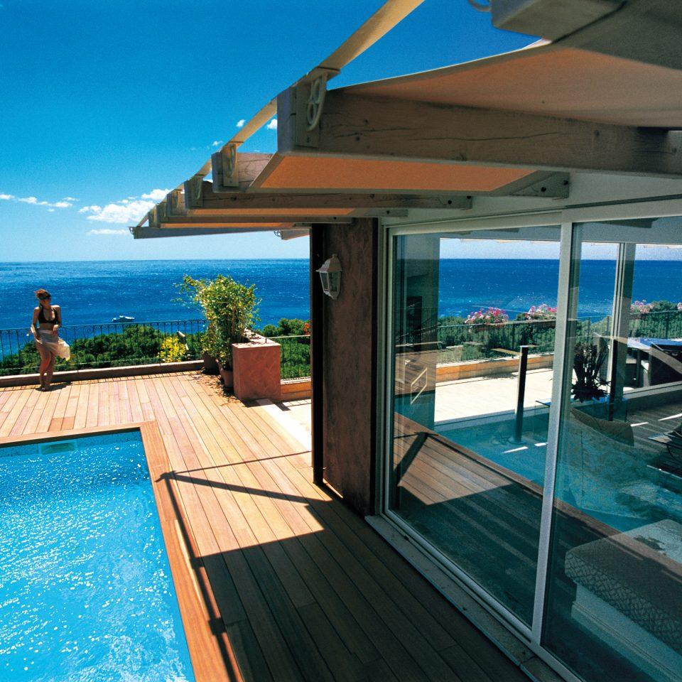 Beachfront Luxury Ocean Pool swimming pool leisure property Resort caribbean Villa Deck shore