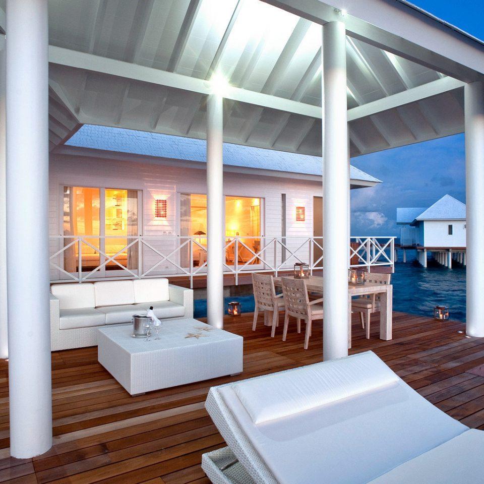 Beachfront Deck Resort chair property house home Villa cottage caribbean condominium swimming pool porch overlooking