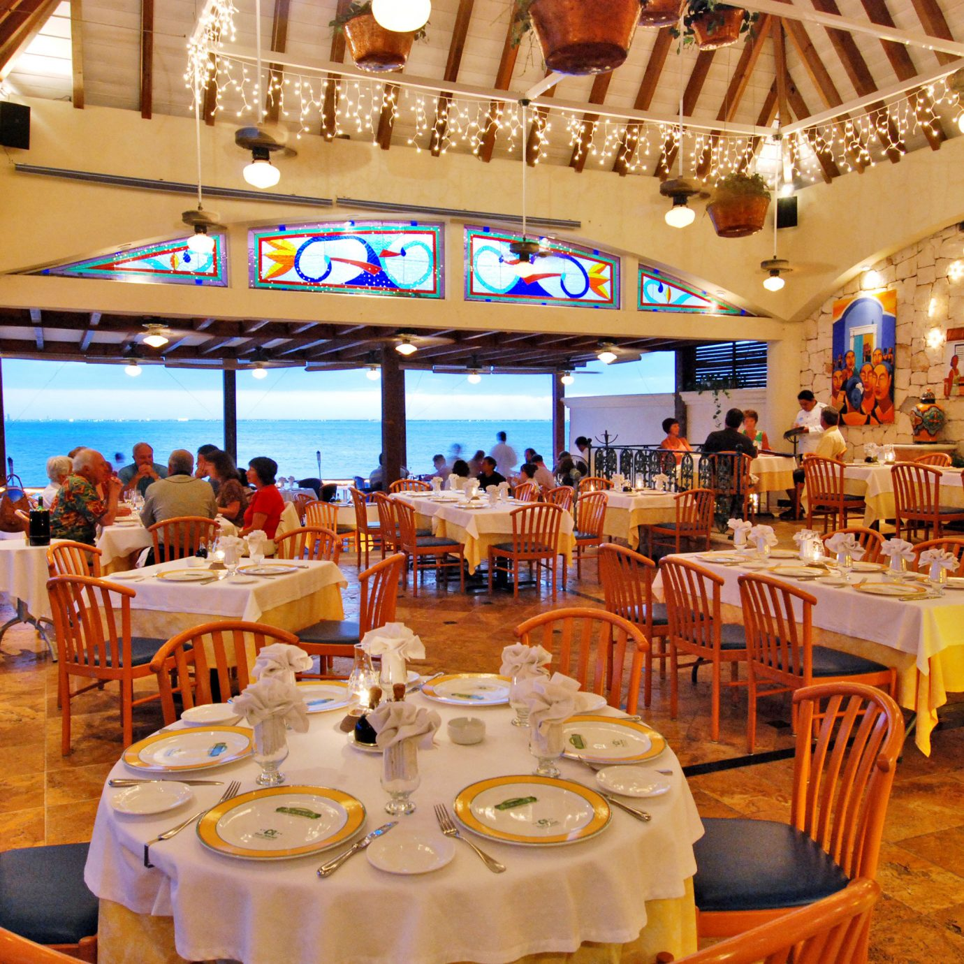 Beachfront Dining Drink Eat Luxury Scenic views Waterfront chair function hall restaurant Resort banquet wedding reception ballroom