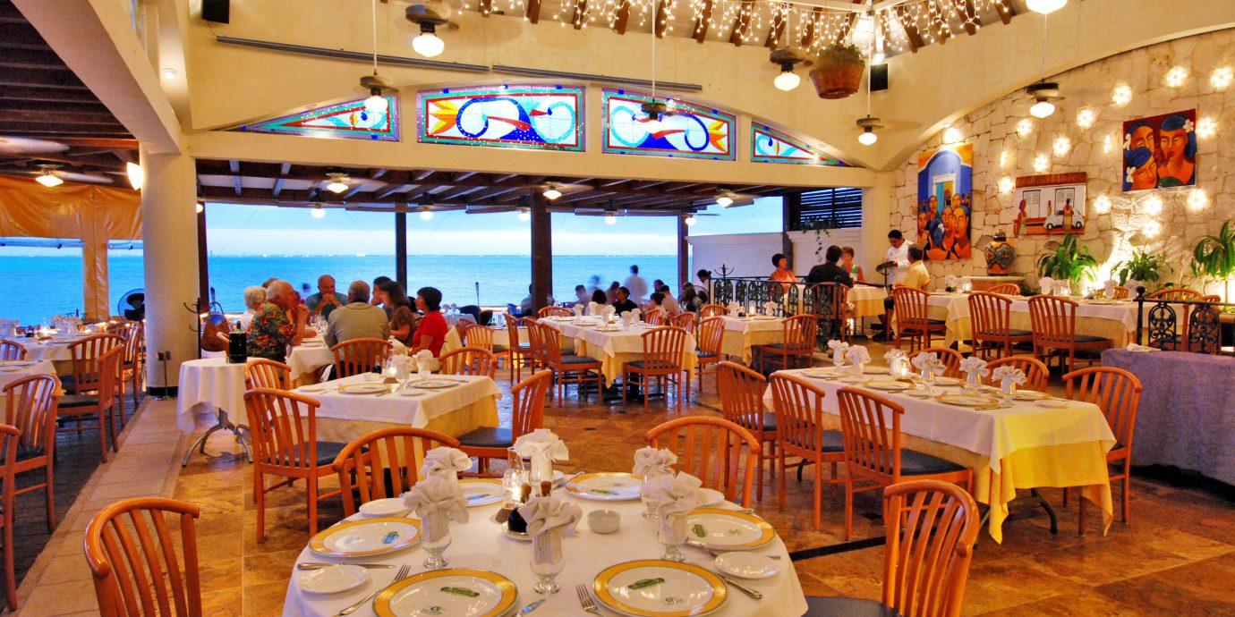 Beachfront Dining Drink Eat Luxury Scenic views Waterfront chair function hall restaurant Resort banquet wedding reception ballroom