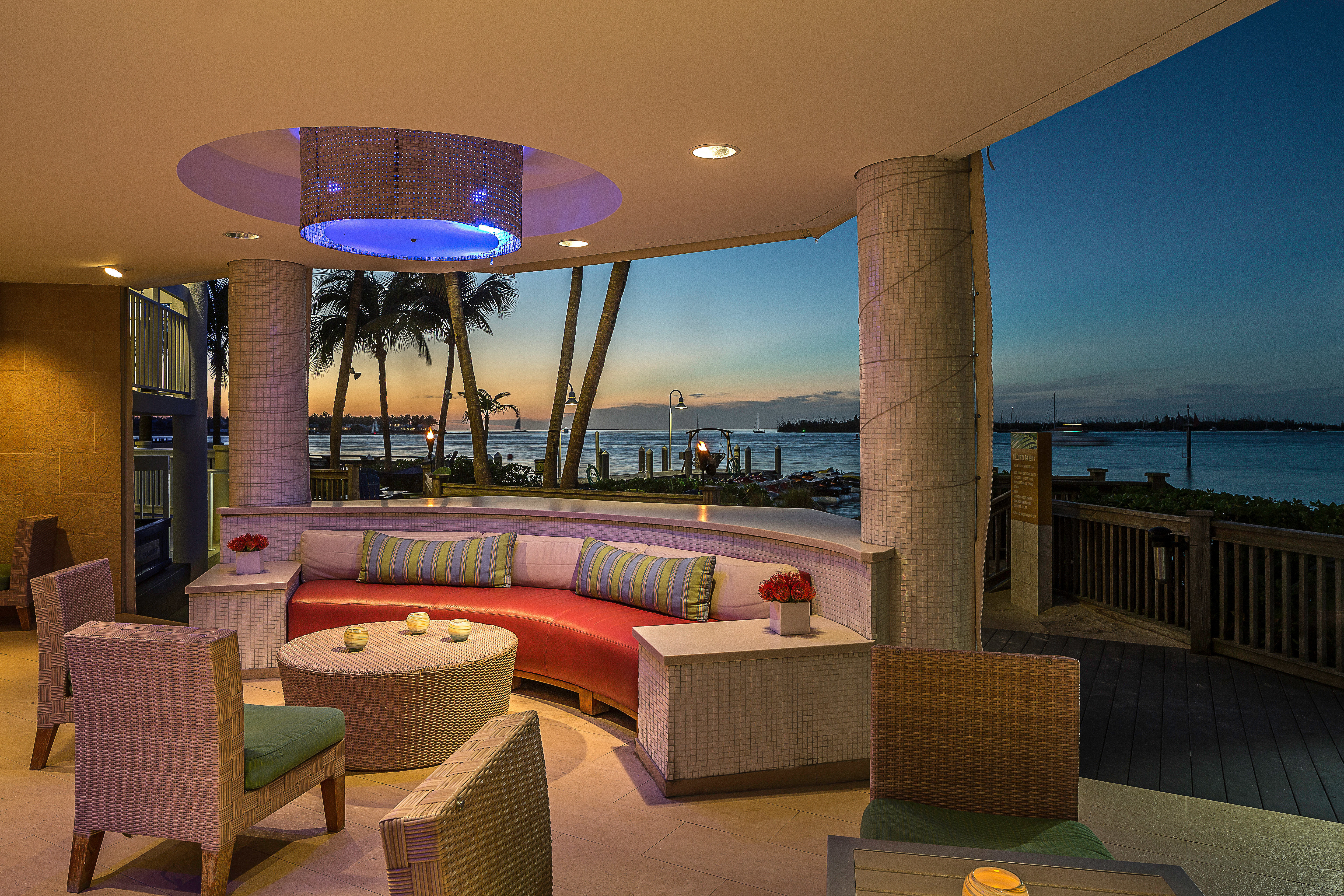 Beachfront Dining Drink Eat Hip Luxury sky chair property Resort swimming pool Villa home condominium restaurant Suite living room colorful