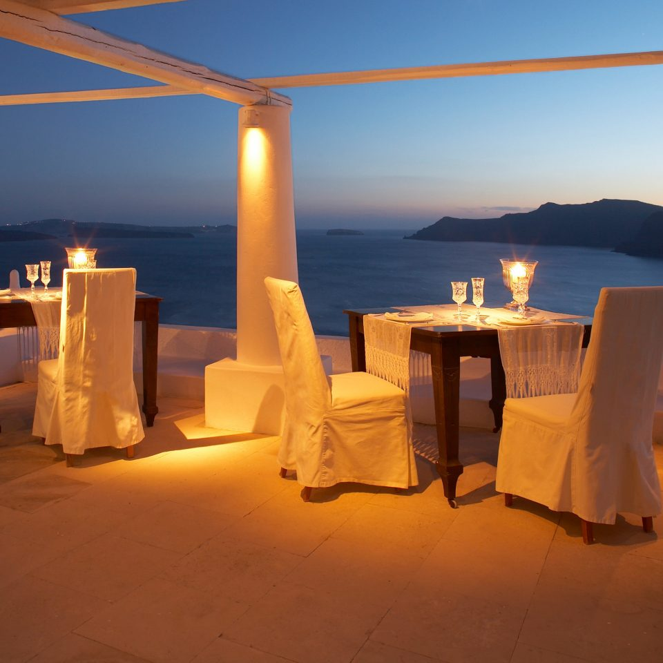 Beachfront Dining Drink Eat Greece Hotels Ocean Romantic Santorini Sunset sky light evening lighting shape restaurant