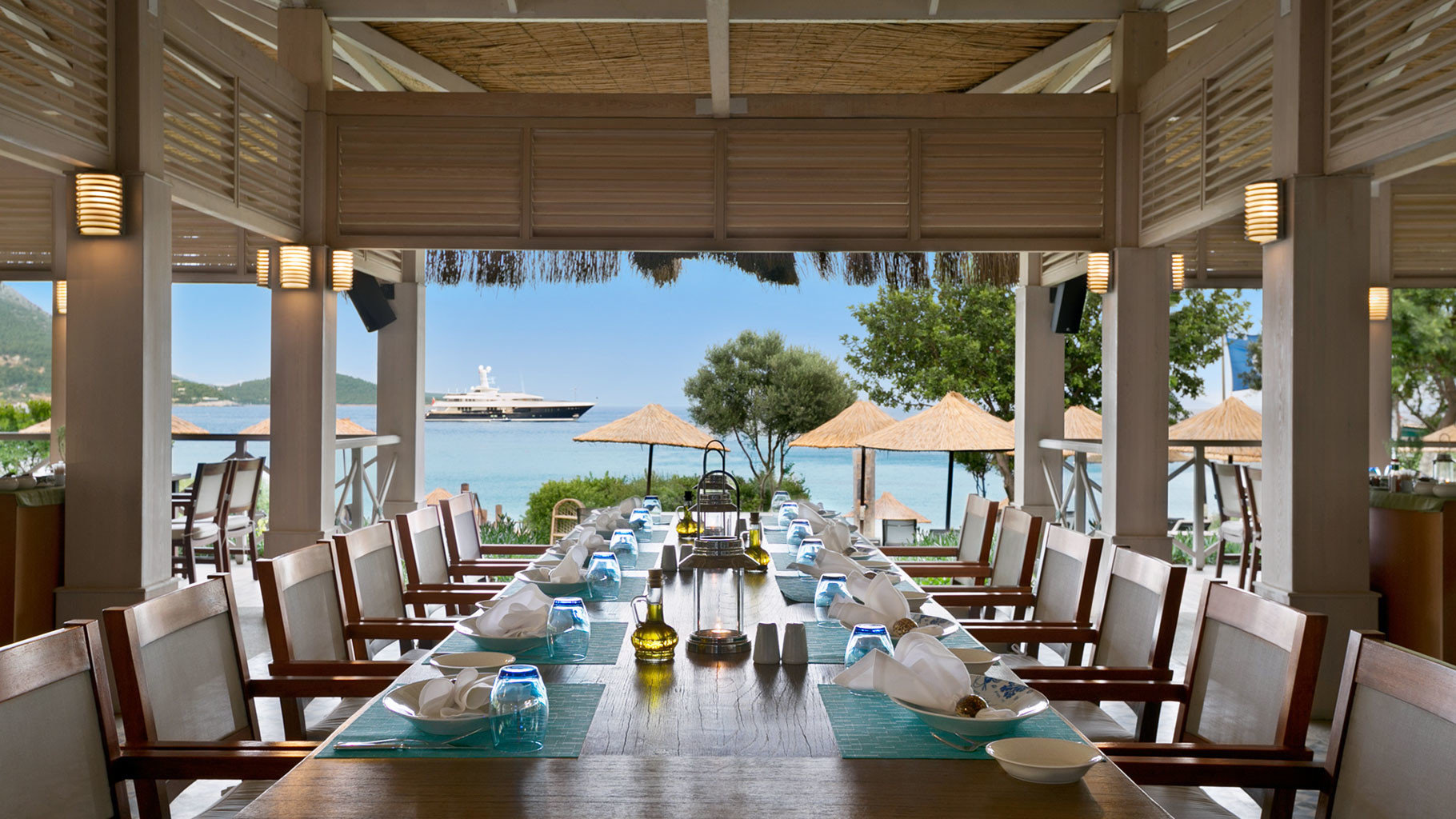Beachfront Dining Drink Eat Family Resort Scenic views chair property restaurant condominium home function hall Lobby Villa living room set overlooking dining table