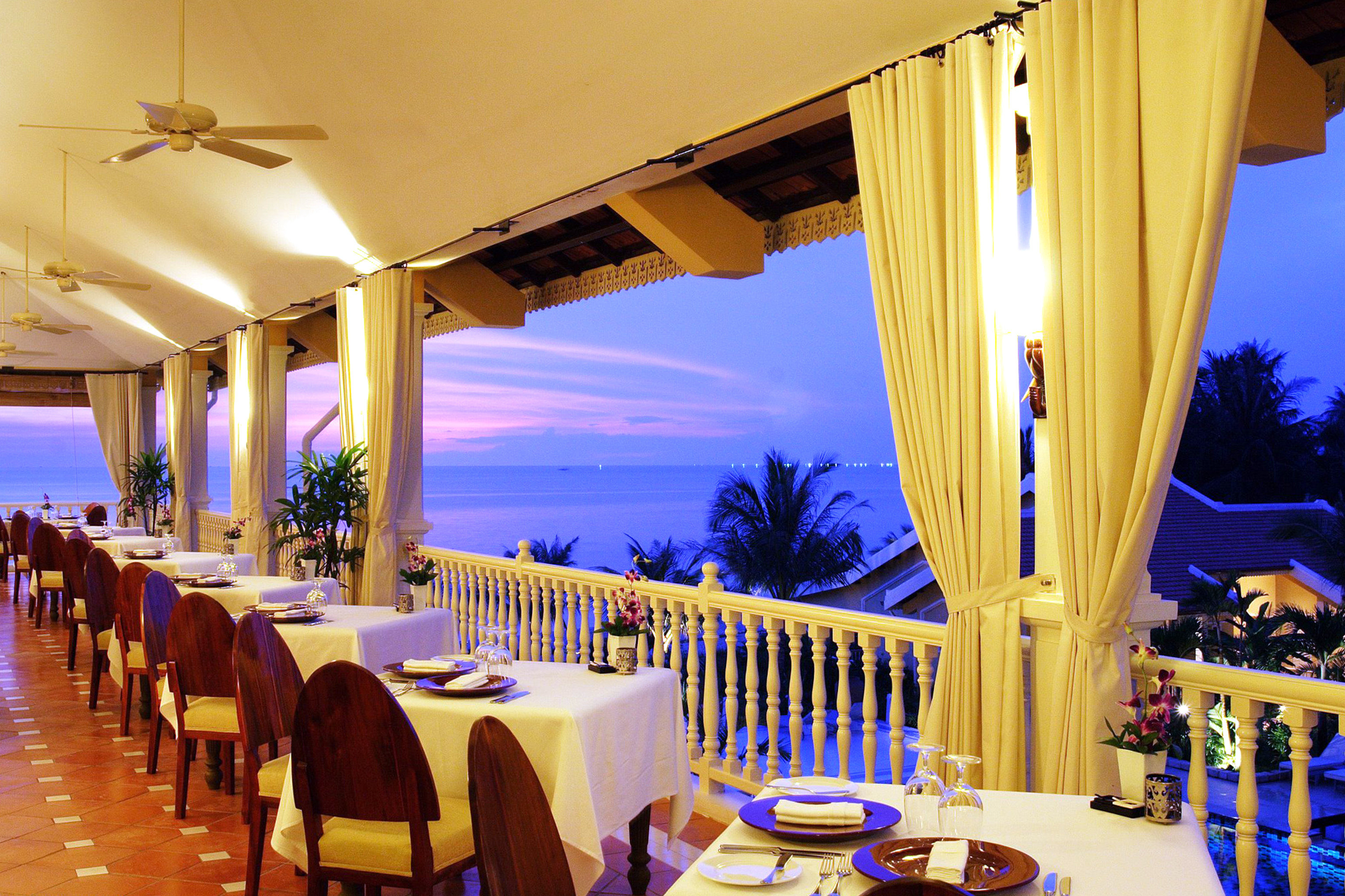 Beachfront Dining Drink Eat Island Patio Resort Romantic Terrace Waterfront chair restaurant function hall Villa