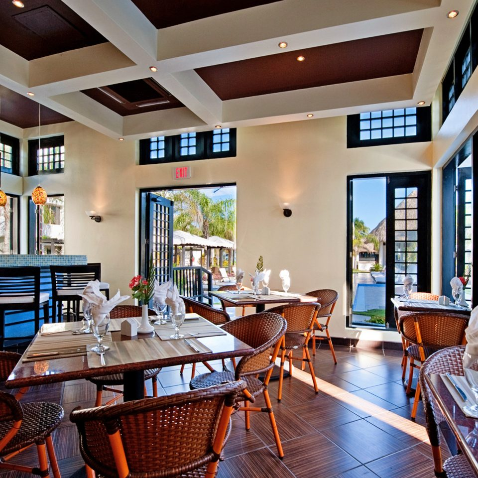 Beachfront Dining Drink Eat Resort chair property condominium home living room Lobby restaurant