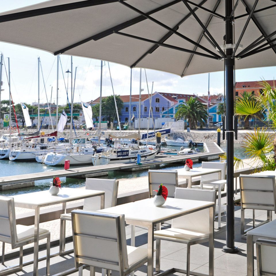 Beachfront Dining Drink Eat Luxury Scenic views sky marina restaurant dock Resort