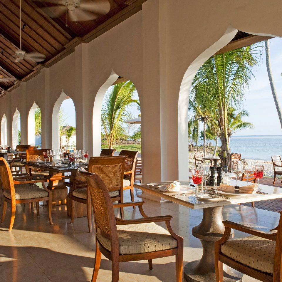 Beachfront Dining Drink Eat Family Luxury Patio Resort Scenic views property chair restaurant home Villa function hall hacienda