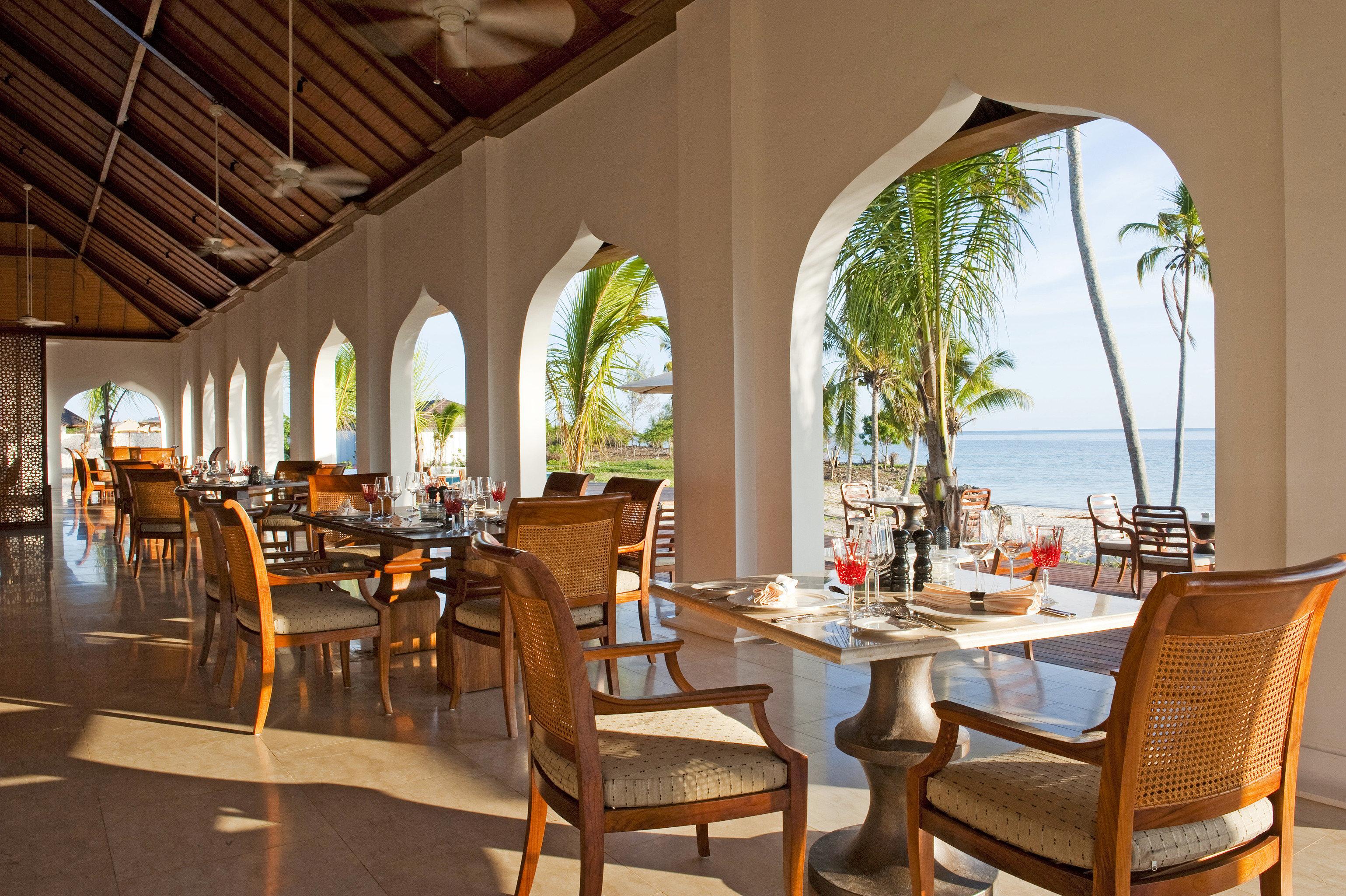 Beachfront Dining Drink Eat Family Luxury Patio Resort Scenic views property chair restaurant home Villa function hall hacienda