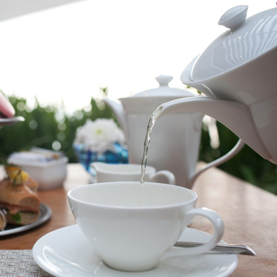 Beachfront Dining Drink Eat Scenic views cup coffee cup saucer ceramic porcelain dishware tableware