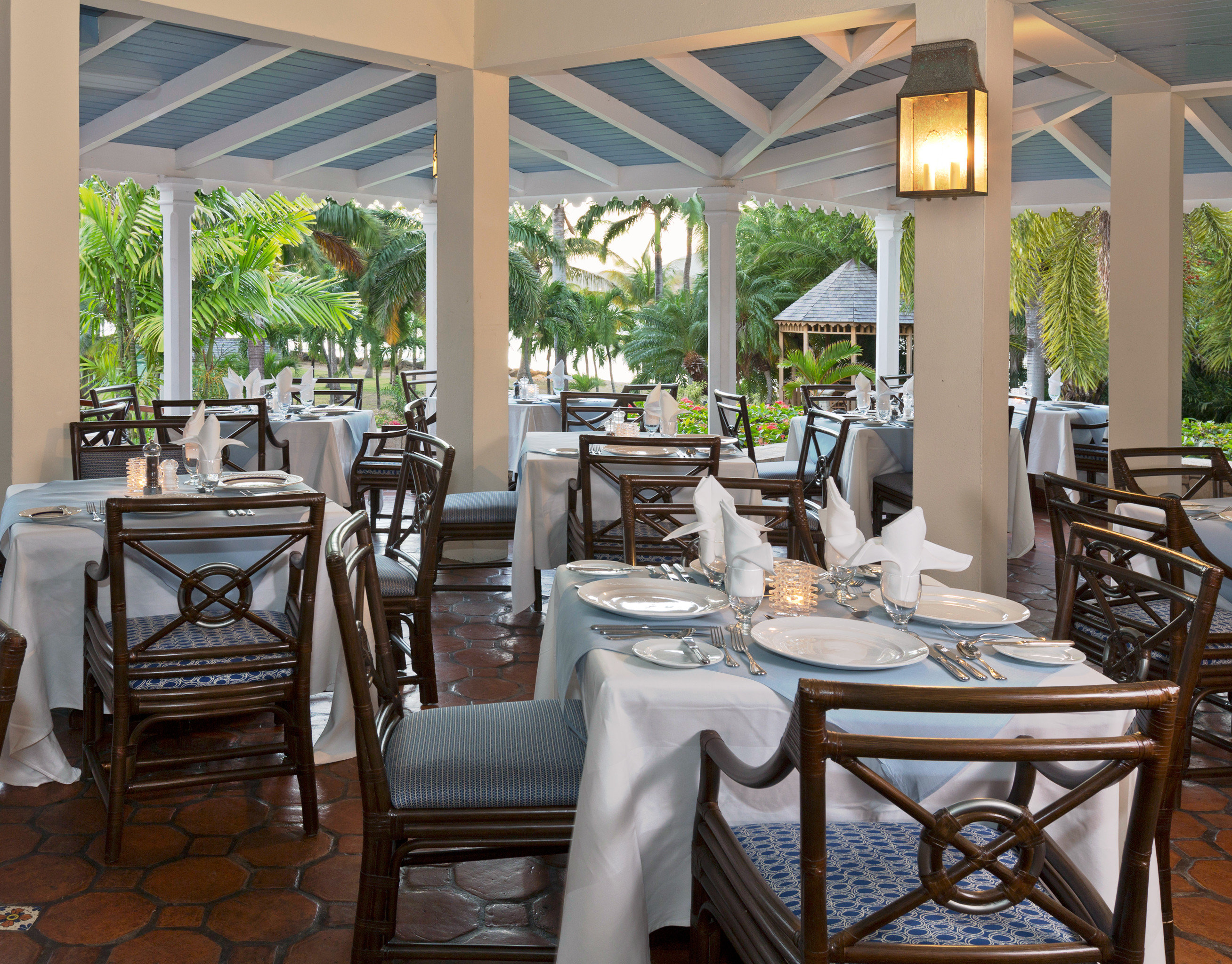 Beachfront Dining Drink Eat Island Romance Romantic Tropical chair property restaurant Resort home porch Villa cottage outdoor structure set dining table