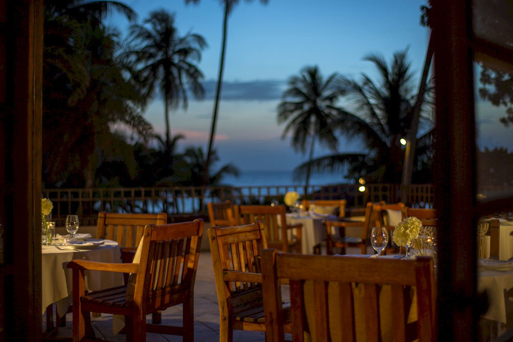 Beachfront Dining Drink Eat Scenic views Tropical chair Resort restaurant hacienda palace set dining table surrounded