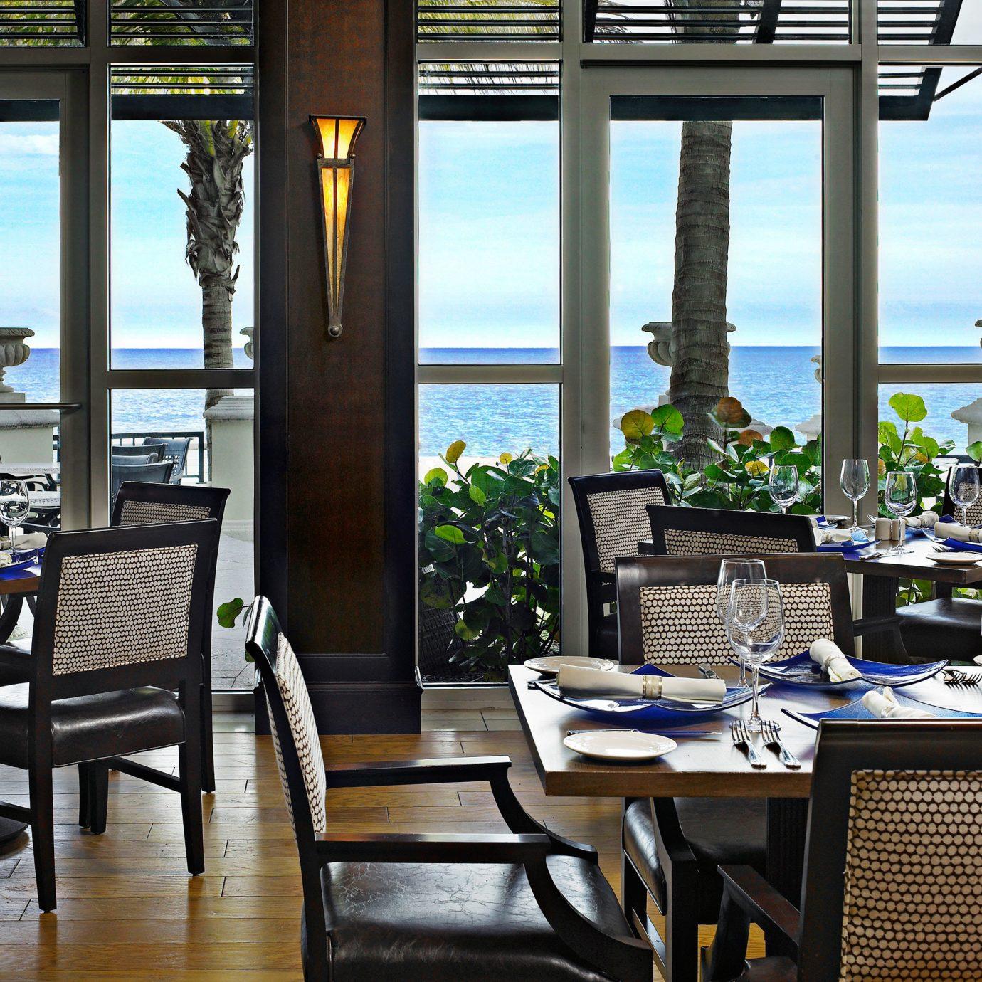 Beachfront Dining Eat Family Modern Trip Ideas chair property restaurant condominium home Resort living room dining table