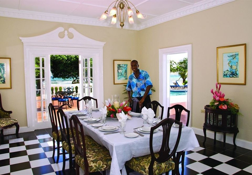 Beachfront Dining Eat Tropical Villa property chair living room home cottage Resort mansion dining table