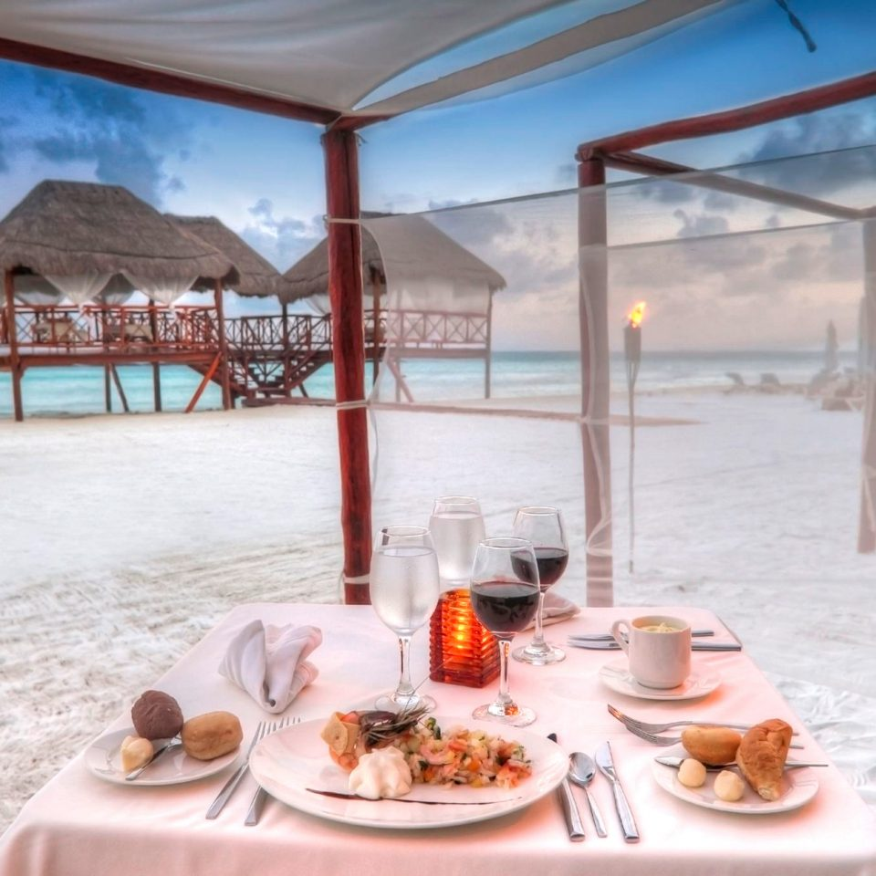 Beachfront Dining Eat Romance Romantic food restaurant swimming pool Resort dining table