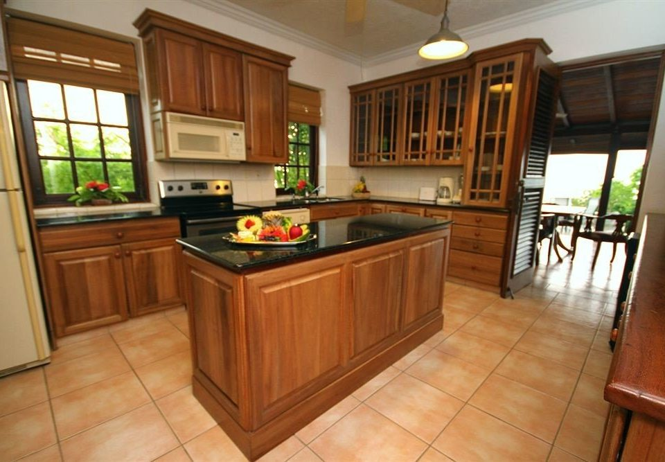Beachfront Dining Historic Kitchen cabinet building property home cabinetry countertop hardwood cuisine classique cottage wood flooring flooring stove mansion farmhouse stainless hard appliance steel Island