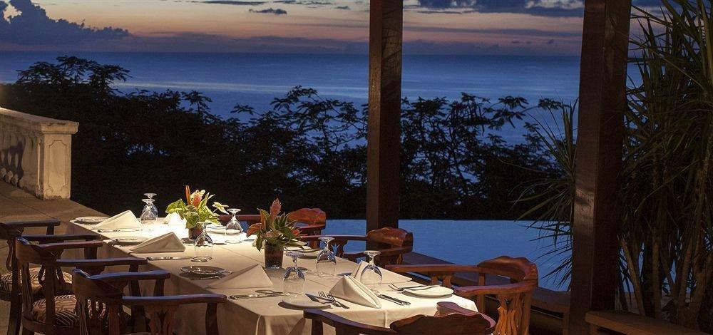 Beachfront Dining Historic tree restaurant Resort evening overlooking Villa set