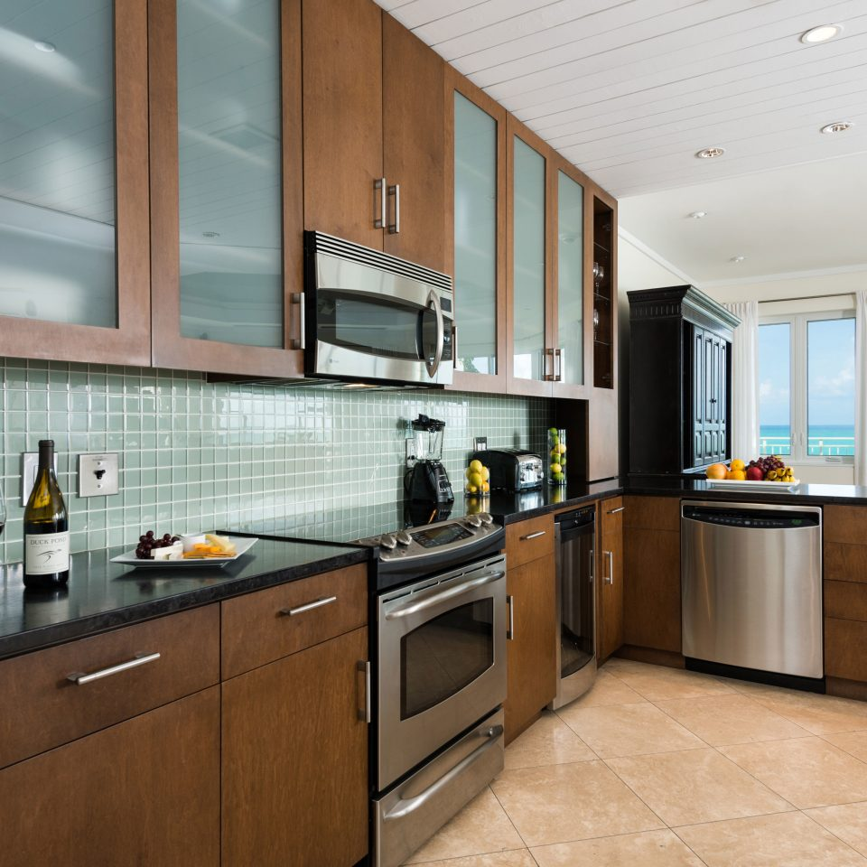 Beachfront Drink Eat Family Kitchen cabinet property cabinetry home countertop appliance stainless hardwood cuisine classique counter steel cottage wood flooring kitchen appliance